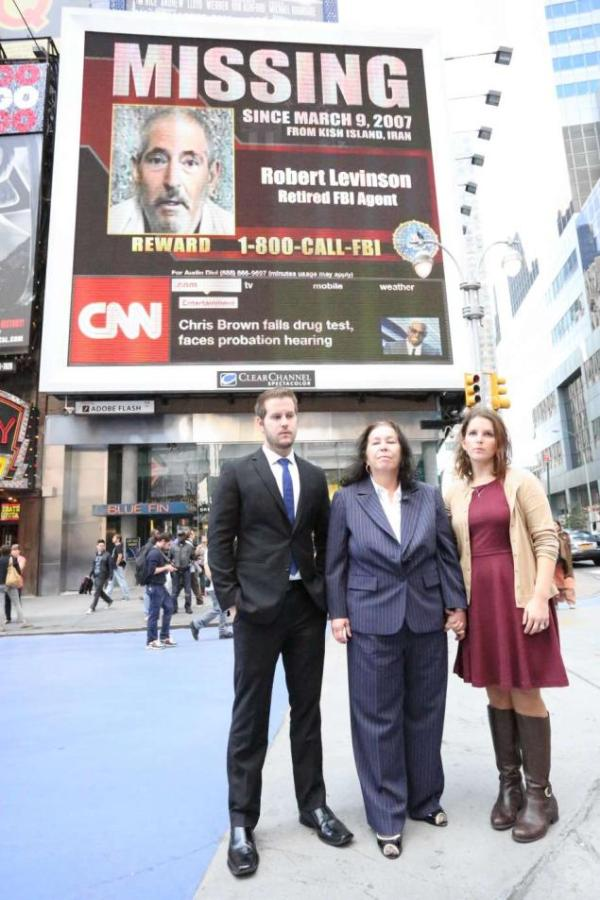 Dan, Christine, and Sarah in front of the Billboard at Times Square